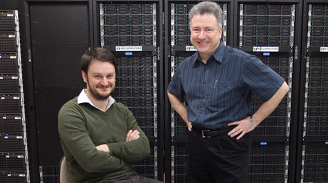 Jozef Dudek (left), staff scientist at Jefferson Lab and an assistant professor of physics at William & Mary, worked with JLab's Robert Edwards to run complex quantum chromodynamics calculations on several supercomputers. (Courtesy Jefferson Lab)