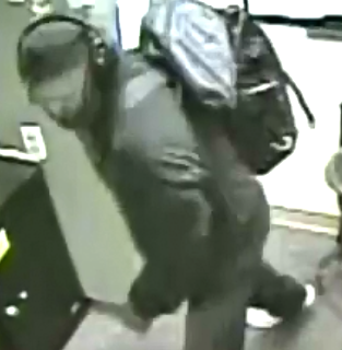 Police seek masked man for alleged burglary at Martin's