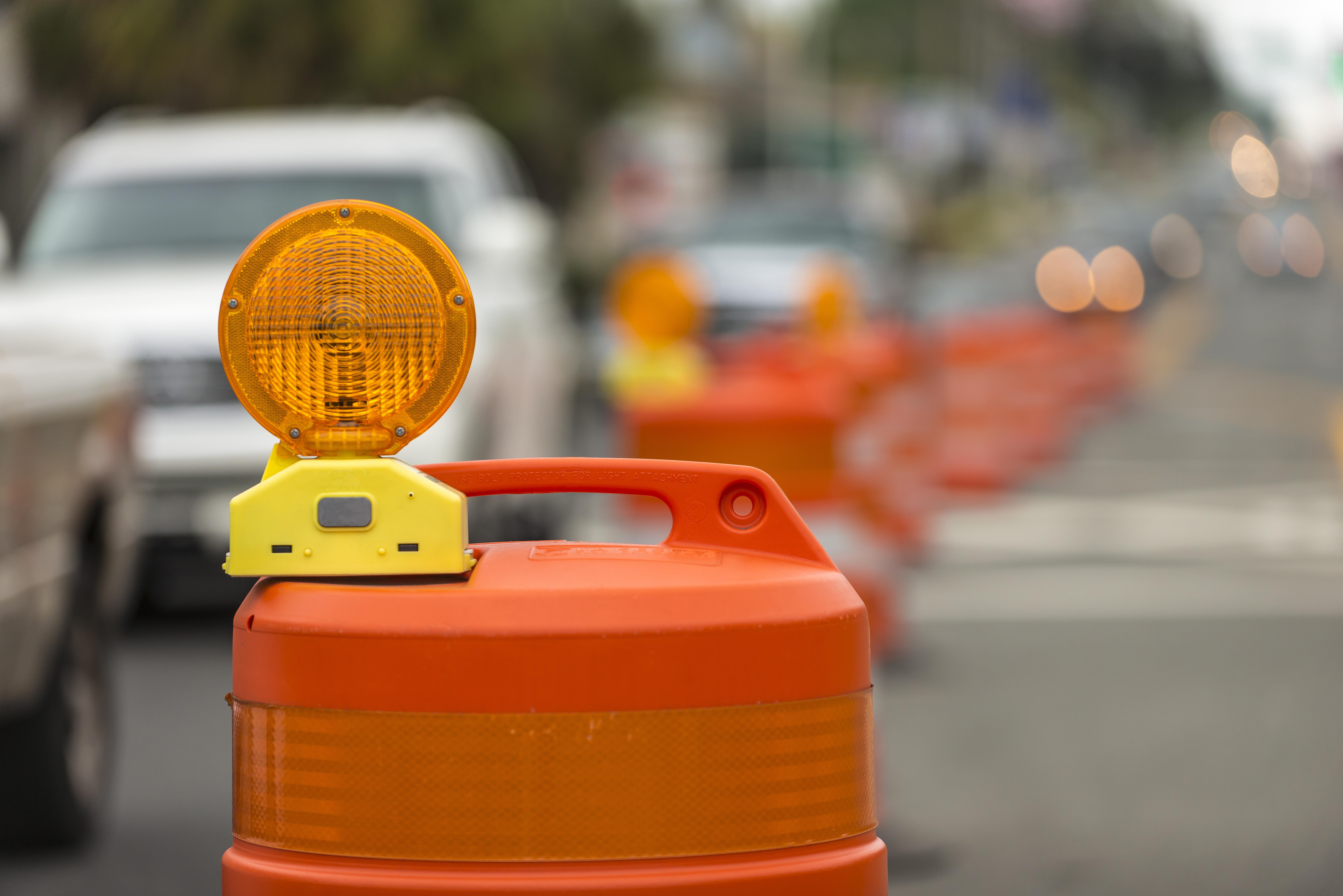 Photo of a road construction barrel.