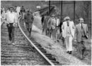 Jurors, attorneys, a judge and other people involved in the Gina Renee Hall murder case walk train tracks during a walk-through of locations related to Hall's murder in 1980. (WYDaily/Courtesy Radford News Journal)