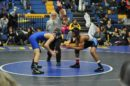 Randall Stowe referees a wrestling match. (WYDaily/Courtesy of Lucy Stowe)