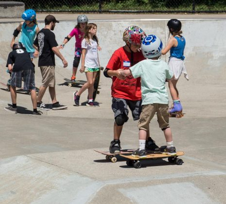 At 10 years old, Locke Pfannebecker is currently TSA's youngest coach. He learned to skate from local Williamsburg skaters, and he's seen here passing on that knowledge to Nick Atkins. (WYDaily Photo/Kellie Thomas)