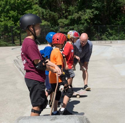 Max Pfannebecker with his son and skate clinic coach, Locke Pfannebecker, teaching some of the weekend's young attendees. (WYDaily Photo/Kellie Thomas)
