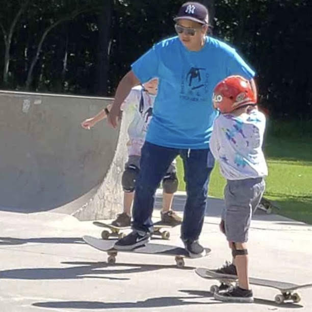 Professional skateboarder Jaime Reyes teaching young Declan White at a recent skate camp in Gloucester. After decades traveling the world (which she still does), Reyes has settled in Williamsburg, and soon plans to teach at free, summer-long skate events in town. (WYDaily Photo/Max Pfannebecker)