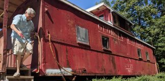 William Fox exits the caboose at the Norge Depot. The caboose is still in need of work, which relies on a varying flow of money and volunteer work. (WYDaily/Sarah Fearing)