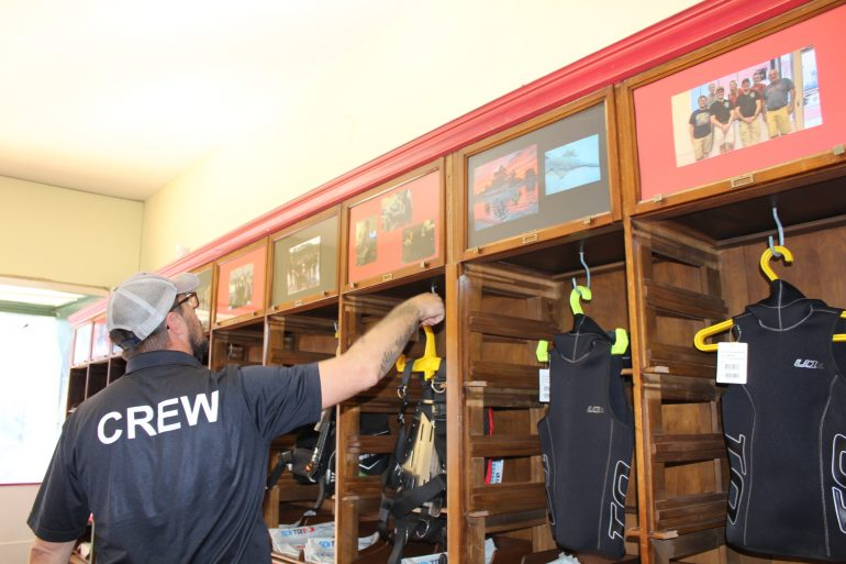David Sowers show some of the equipment in his dive shop in Phoebus. (WYDaily/ Julia Marsigliano)