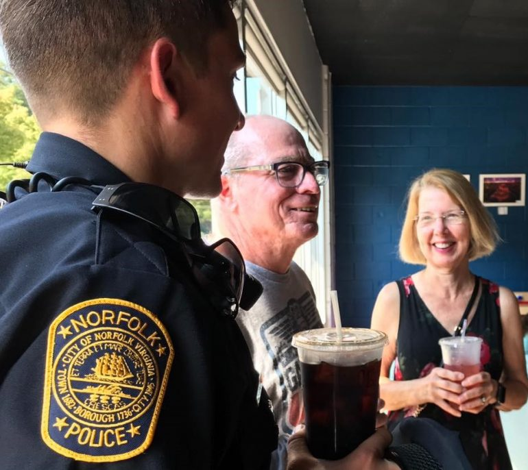 """A Norfolk police officer meets residents at the agency's """"Coffee with a Cop"""" event. (Southside Daily/Courtesy the Norfolk Police Department)"""